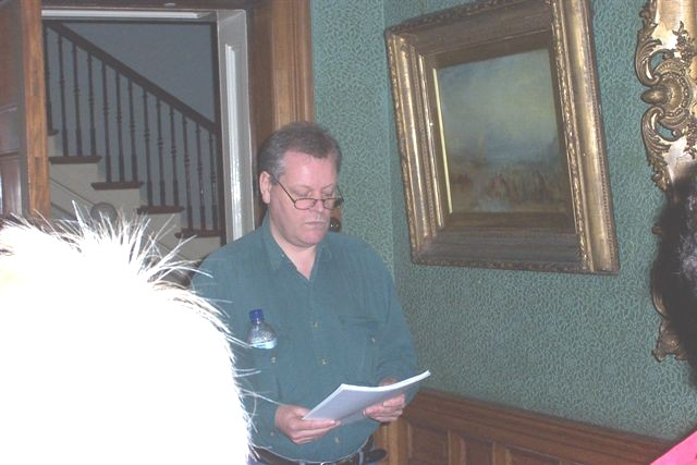 Robert Sheppard reading at Studley House, beside Turner's 'The Wreck Buoy'