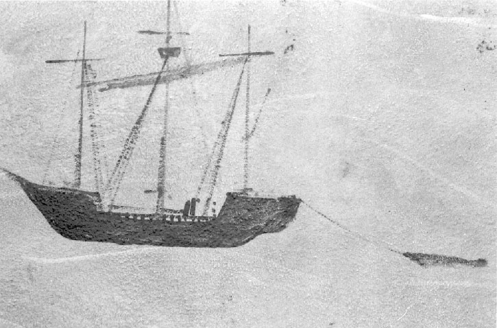 on a rock, perhaps, a three-masted vessel, towing